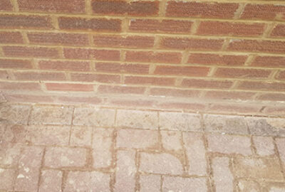 New pointing on brick wall with brick path