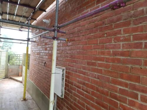 New pointing on brick wall situated under scaffolding