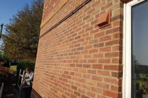 New pointing on brick wall on corner of the house