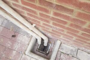 New pointing of brick work above drain