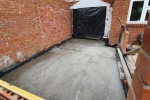 concrete screening on floor with new brick walls