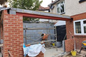 half built brick extension showing exposed roof beam