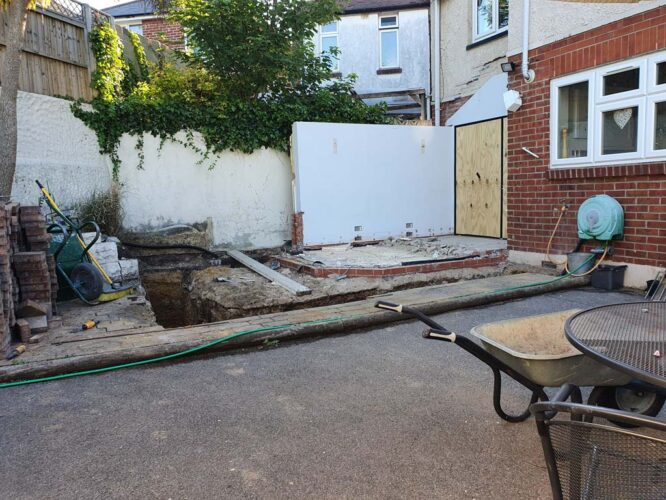 walls knocked down with new trenches in the floor ready for new extension