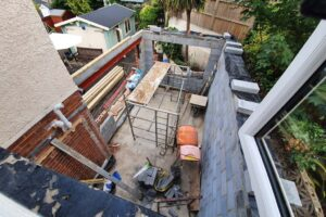 exposed brick extension view from top with builders tools and scaffolding