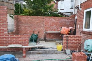 side view of brick extension but no roof