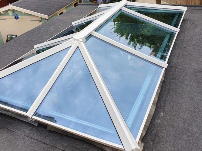 newly installed sky light on felt roof overlooking garden