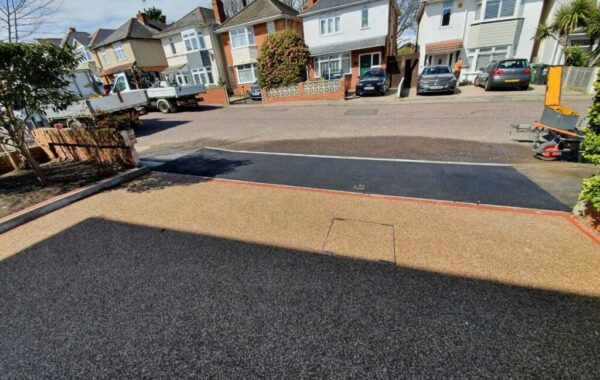 view onto the road of resin driveway and new tarmac dropped kerb
